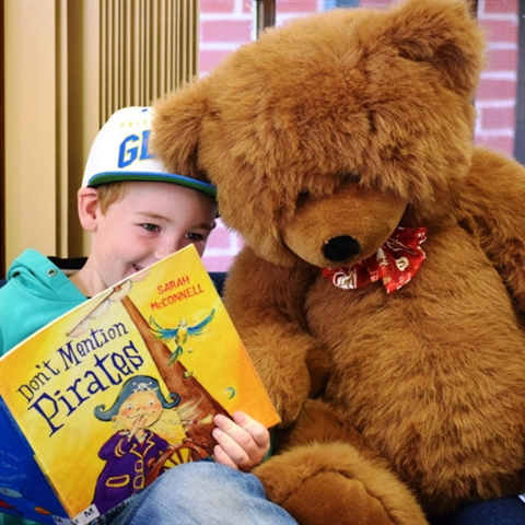 Sharing a story with my bear friend